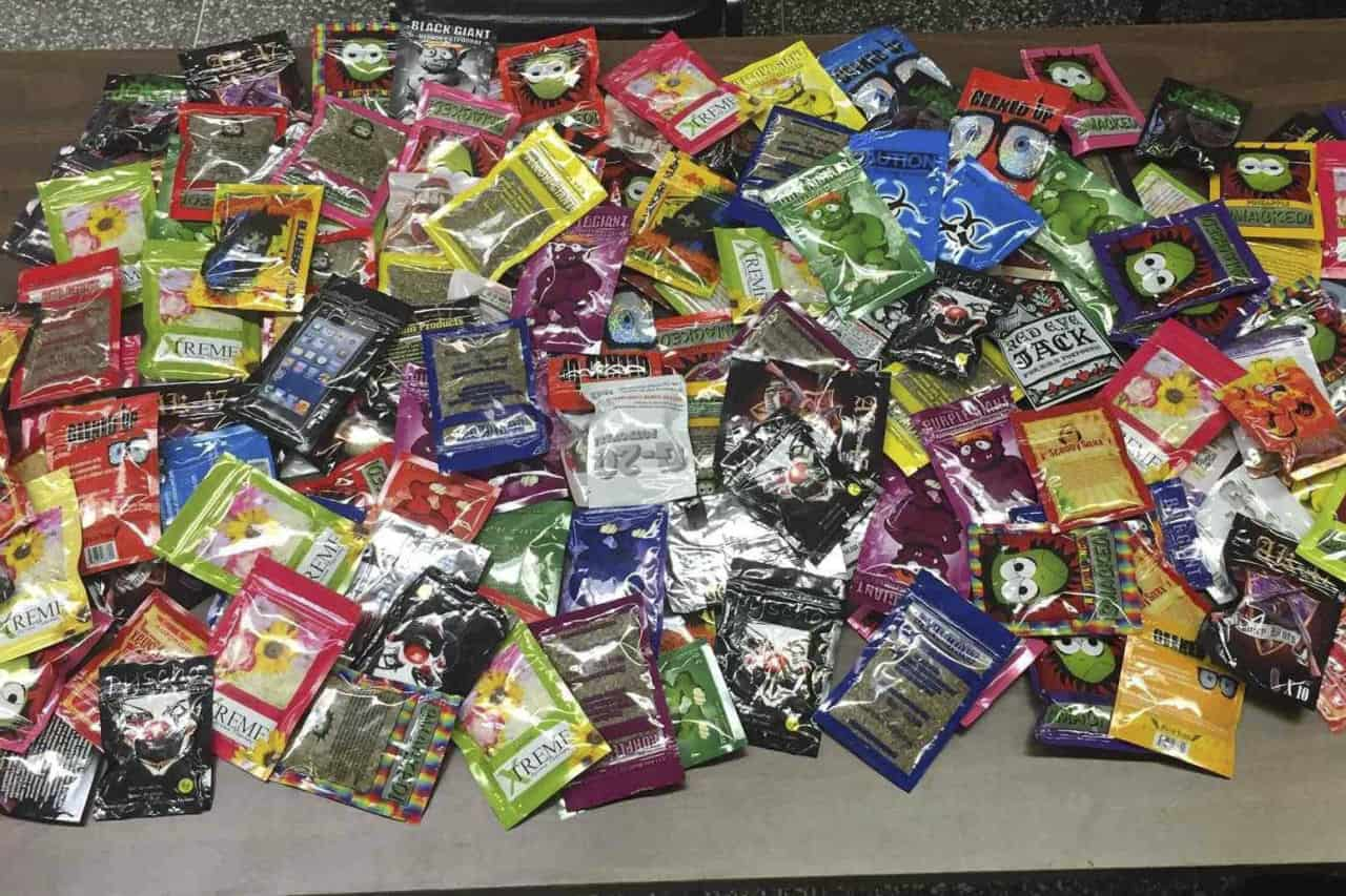 This photo provided Friday, Aug. 7, 2015 by New York Police Department shows packets of synthetic marijuana seized after a search warrant was served at a newsstand in Brooklyn, N.Y. (AP Photo/New York Police Department)